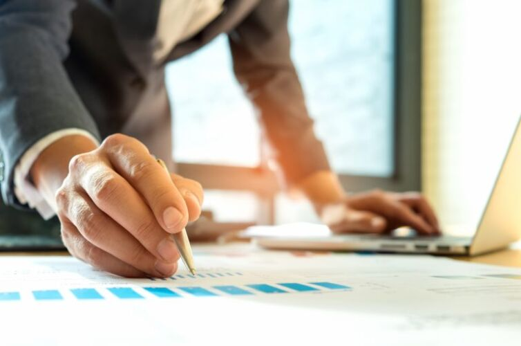 businessmen-are-analyzing-graphs-and-using-laptop-PBGUZ7X-768x509